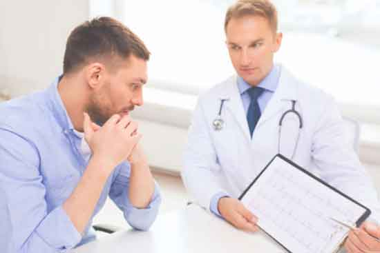 man with his doctor