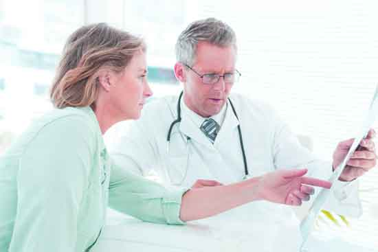 doctor consulting woman patient